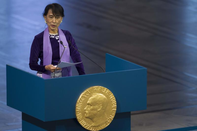 Myanmar opposition leader Aung San Suu Kyi, holds her speech during the Peace Nobel Prize lecture at the city hall in Oslo, Saturday, June 16, 2012. Burmese opposition leader Aung San Suu Kyi Nobel peace prize laureate, formally accepts the prize that thrust her into the global limelight two decades ago. Suu Kyi says the Nobel Peace Prize she won while under house arrest 21-years ago helped to shatter her sense of isolation and ensured that the world would demand democracy in her military-controlled homeland. (AP Photo/Markus Schreiber)
