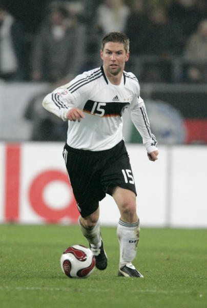 """In this picture taken Nov. 17, 2007 Germany's Thomas Hitzlsperger goes with the ball during the Group D Euro 2008 qualifying soccer match between Germany and Cyprus in Hannover, northern Germany. Former Germany midfielder Thomas Hitzlsperger announced he is gay on Wednesday Jan. 8, 2014, becoming likely the most prominent footballer yet to break a long-standing taboo within the sport. Hitzlsperger says in an interview given to Die Zeit newspaper, """"I am expressing my sexuality because I want to promote the discussion of homosexuality among professional athletes."""" The 31-year-old says he felt now was the right time, four months after retirement following a career in England, Italy and Germany, to approach a subject he feels is """"simply ignored."""" (AP Photo/Joerg Sarbach)"""