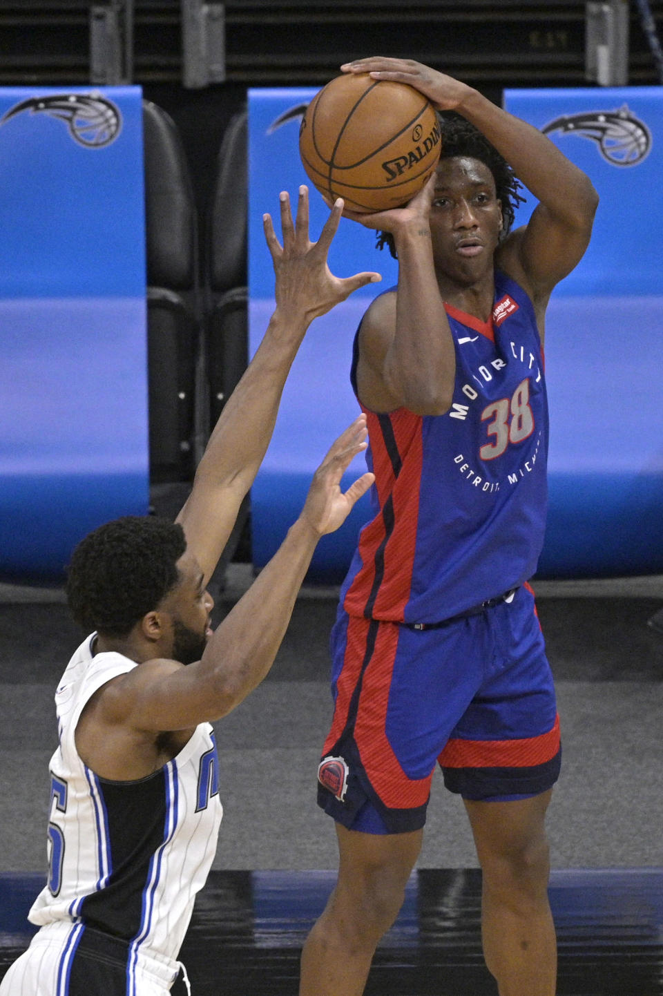 Detroit Pistons guard Saben Lee (38) attempts a 3-point shot in front of Orlando Magic guard Chasson Randle (25) during the first half of an NBA basketball game, Tuesday, Feb. 23, 2021, in Orlando, Fla. (AP Photo/Phelan M. Ebenhack)