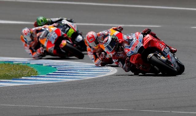 Motorcycle Racing - MotoGP - Spanish Grand Prix - Circuito de Jerez - Angel Nieto, Jerez de la Frontera, Spain - May 6, 2018 Ducati Team's Jorge Lorenzo in action with Repsol Honda Team's Marc Marquez and Dani Pedrosa during the race REUTERS/Jon Nazca