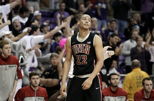 UNLV 's Chace Stanback (22) reacts in the final seconds of overtime in an NCAA college basketball game against TCU Tuesday, Feb. 14, 2012, in Fort Worth, Texas. Stanback had 17 points in the 102-97 loss to TCU. (AP Photo/Tony Gutierrez)