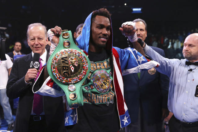 Jermall Charlo celebrates after defeating Ireland's Dennis Hogan during the seventh round of the WBC middleweight title boxing match Saturday, Dec. 7, 2019, in New York. (AP Photo/Michael Owens)