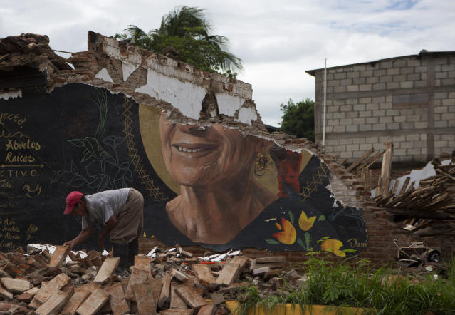 <p>A man recovers bricks from a building destroyed in Thursday's magnitude 8.1 earthquake, in Union Hidalgo, Oaxaca state, Mexico, Sunday, Sept. 10, 2017. Mexico's government is distributing food to jittery survivors of an earthquake while residents have continued to sleep outside, fearful of more collapses and aftershocks. (AP Photo/Rebecca Blackwell) </p>