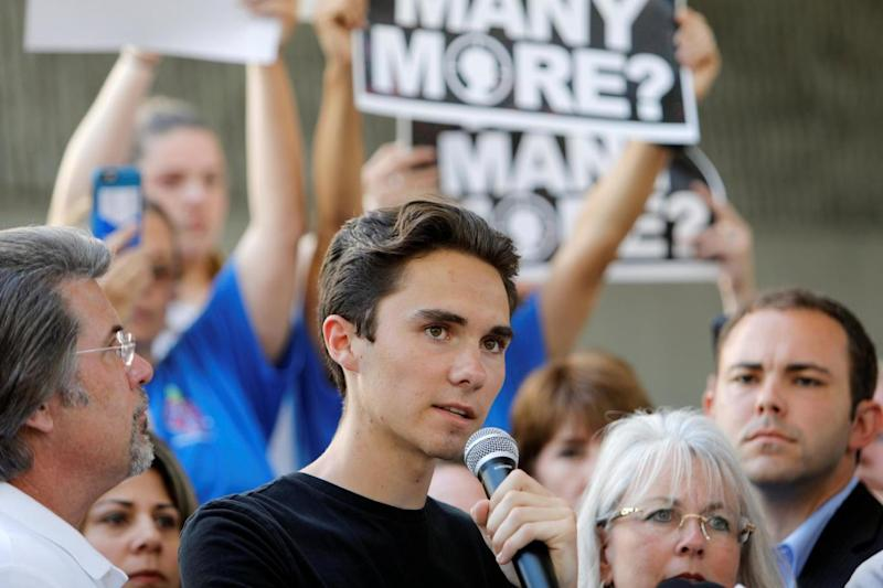 David Hogg, a senior at Marjory Stoneman Douglas High School, speaks at a rally (REUTERS)