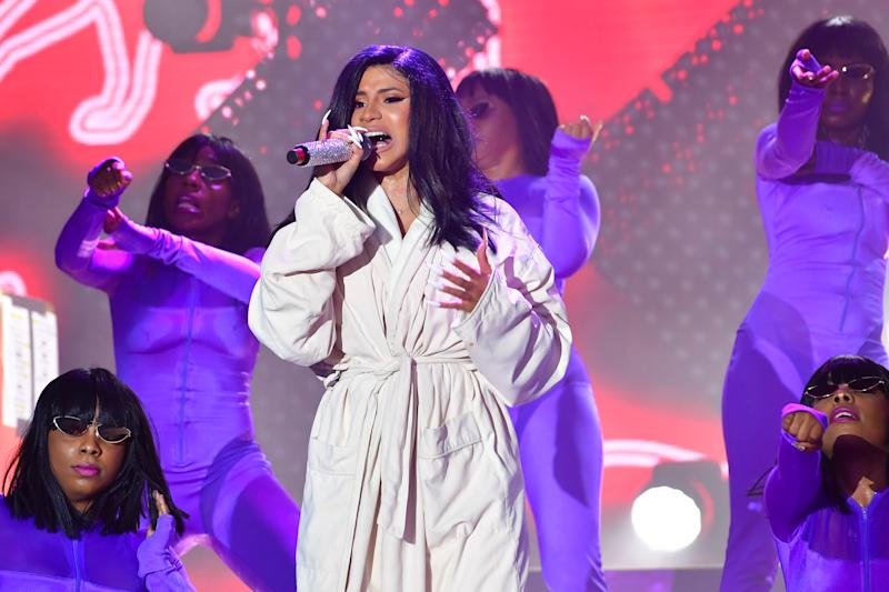 Cardi B performs wearing a white bathrobe during 2019 Bonnaroo Music & Arts Festival on June 16, 2019 in Tennessee.