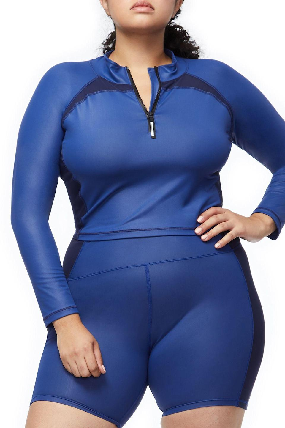 "<p>I am getting scuba vibes with this long-sleeved, high-neck crop top and matching shorts. It will also look awesome if you pair it with leggings for those colder days.<br><a href=""https://fave.co/2SxmYPe"" rel=""nofollow noopener"" target=""_blank"" data-ylk=""slk:Shop it:"" class=""link rapid-noclick-resp""><strong>Shop it:</strong> </a>The Power Crop Top, $95 (take 25% off with code EXTRA25), <a href=""https://fave.co/2SxmYPe"" rel=""nofollow noopener"" target=""_blank"" data-ylk=""slk:goodamerican.com"" class=""link rapid-noclick-resp"">goodamerican.com</a><br><a href=""https://fave.co/2Av6M9U"" rel=""nofollow noopener"" target=""_blank"" data-ylk=""slk:Shop it:"" class=""link rapid-noclick-resp""><strong>Shop it:</strong> </a>The Boy Short, $75 (take 25% off with code EXTRA25), <a href=""https://fave.co/2Av6M9U"" rel=""nofollow noopener"" target=""_blank"" data-ylk=""slk:goodamerican.com"" class=""link rapid-noclick-resp"">goodamerican.com</a> </p>"