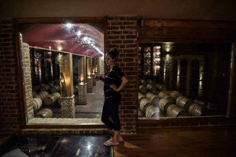 Wine industry professional Nana Chrysochoou is concerned about the impact of a warming climate on the vineyards (AFP/Sakis MITROLIDIS)