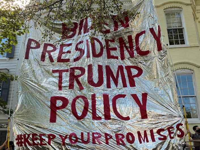 Protesters from Never Again Action hold up a gigantic foil emergency blanket outside the home of Homeland Security secretary Alejandro Mayorkas (Never Again Action / Twitter)
