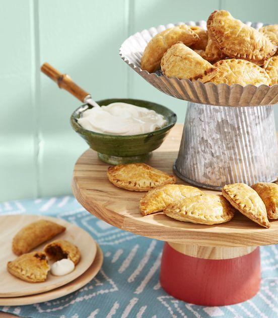 """<p>A simpler, snackable version of the traditional British Christmas meat pie, these savory-sweet hand pies are irresistibly good. They're also mess-free.<br></p><p><strong><a href=""""https://www.countryliving.com/food-drinks/a35914070/beef-and-raisin-empanadas-recipe/"""" rel=""""nofollow noopener"""" target=""""_blank"""" data-ylk=""""slk:Get the recipe"""" class=""""link rapid-noclick-resp"""">Get the recipe</a>.</strong></p>"""