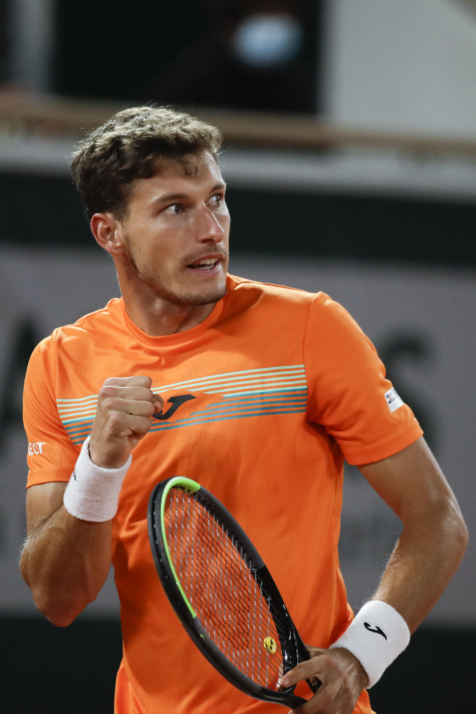 Spain's Pablo Carreno Busta clenches his fist after scoring a point against Germany's Daniel Altmaier in the fourth round match of the French Open tennis tournament at the Roland Garros stadium in Paris, France, Monday, Oct. 5, 2020. (AP Photo/Alessandra Tarantino)