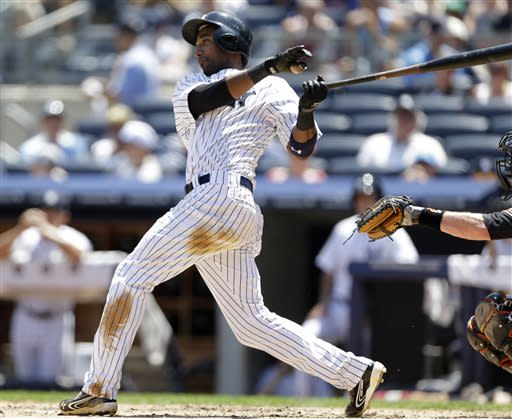 New York Yankees' Eduardo Nunez hits a second-inning sacrifice fly that allowed teammate Zoilo Almonte to score during a baseball game against the Baltimore Orioles, Sunday, July 7, 2013, in New York. (AP Photo/Kathy Willens)