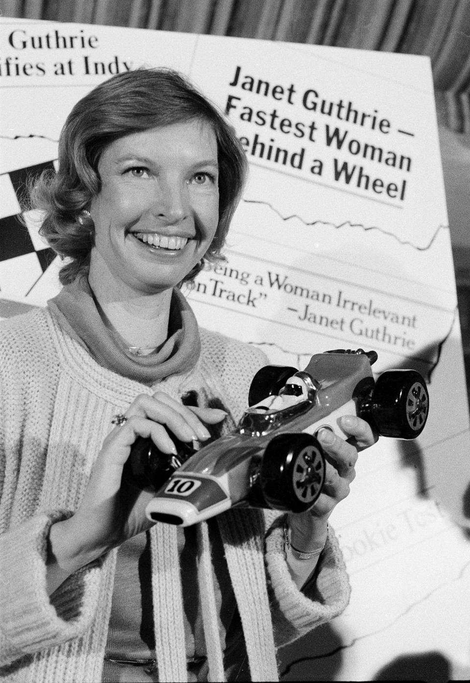 FILE - Janet Guthrie poses with a toy race car at a news conference in New York, in this April 6, 1978, file photo. Janet Guthrie is still astonished at all the fan mail that pours in from around the world. And she's honored to hear that Academy Award winner Hilary Swank wants to portray her in a movie. Forty-four years after her history making run at the Indianapolis 500, Guthrie's impact on the growth of female sports is certainly a legacy worth remembering. (AP Photo/Marty Lederhandler, File)