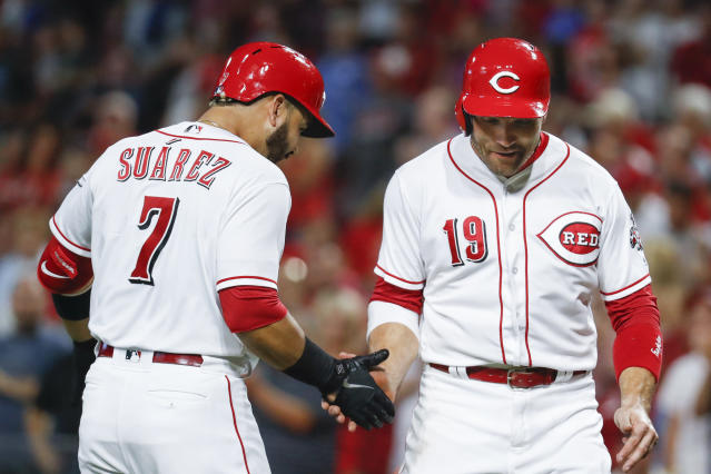 Cincinnati Reds' Eugenio Suarez (7) celebrates with Joey Votto (19) after hitting a two-run home run off St. Louis Cardinals starting pitcher Austin Gomber during the seventh inning of a baseball game Tuesday, July 24, 2018, in Cincinnati. (AP Photo/John Minchillo)