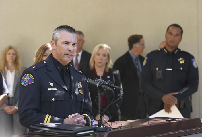 Commander Aaron Johnson, of the Rohnert Park Police Department, left, discusses the arrest of Roy Charles Waller, who is suspected of committing a series of rapes, during a news conference Friday, Sept. 21, 2018, in Sacramento, Calif. Waller, 58, was arrested on Thursday, Sept. 20, by Sacramento Police, and is suspected of committing at least 10 rapes across Northern California between 1991 and 2006. In the background is Sacramento County District Attorney Anne Marie Schubert, center, Sacramento Police Chief Daniel Hahn, right. (AP Photo/Rich Pedroncelli)