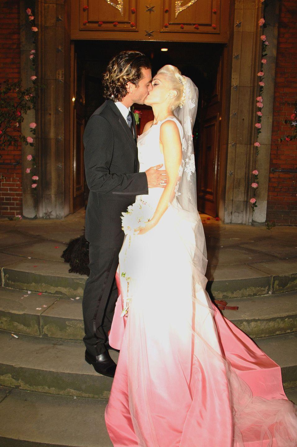 <p>In a move that only a true rockstar could pull off, No Doubt singer Gwen Stefani married Bush singer Gavin Rossdale while wearing a wild Christian Dior dress designed by John Galliano that featured a striking white-to-pink gradient and a lengthy train.</p>