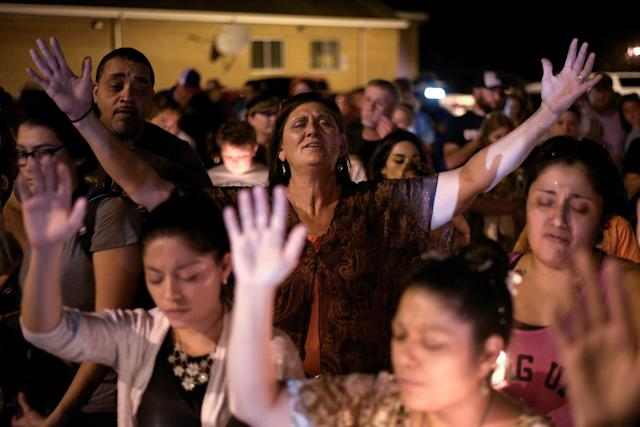 <p>Michaun Johnson attends a candle light vigil after a mass shooting at the First Baptist Church in Sutherland Springs, Texas, Nov. 5, 2017. (Photo: Sergio Flores/Reuters) </p>