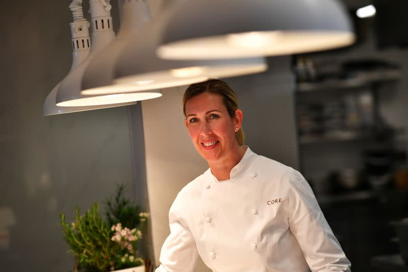Britain's newest winner of three Michelin stars, Clare Smyth smiles at her Core restaurant in London