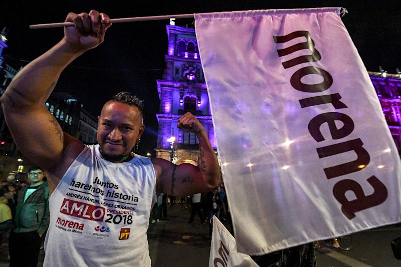 """Thousands of ecstatic Lopez Obrador supporters flooded the capital's central district, chanting """"Yes we did!"""" and partying to mariachi music (AFP Photo/ULISES RUIZ)"""