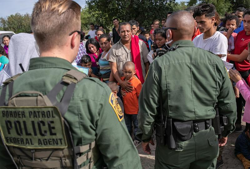 U.S. Border Patrol agents watch over immigrants after taking them into custody on July 02, 2019 in Los Ebanos, Texas.   John Moore—Getty Images