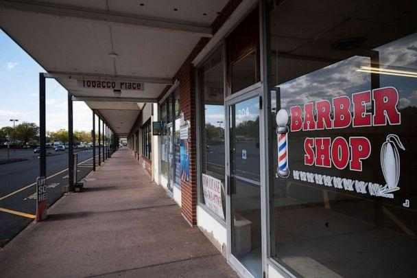 PHOTO: A barbershop has gone out of business and the space is for lease in the Pennywise Shopping Center in Wethersfield, Connecticut, on May 7, 2020. (Mark Lennihan/AP)