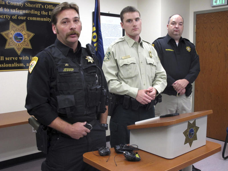 From left, Missoula County Sheriff's Deputy Ross Jessop, U.S. Forest Service Law Enforcement Officer Nick Scholz and Sheriff T.J. McDermott answer questions on Tuesday, July 10, 2018, in Missoula, Mont., about a baby found in the woods at least nine hours after being abandoned. Jessop and Scholz found the 5-month-old boy covered in a pile of sticks and debris early Sunday, July 9, 2018. (AP Photo/Matt Volz)