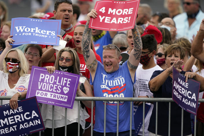 People arrive ahead of a campaign rally with President Donald Trump Tuesday, Sept. 8, 2020, in Winston-Salem, N.C. (AP Photo/Chris Carlson)