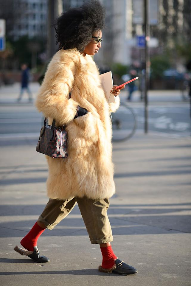 <p>Bare ankles and exposed feet are unpleasant when it's chilly. Pair your favorite flats with a pair of warm socks for an unexpected look that will help keep you warm. If your shoes tend to run small, aim for a pair of socks with less bulk; that way, your shoes won't pinch.</p>