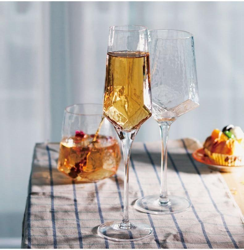 """<p>karenjaihome.com</p><p><strong>$28.00</strong></p><p><a href=""""https://karenjaihome.com/collections/dine/products/diamond-shape-wine-glass-cup-lead-free-crystal-glass-champagne-glasses-water-cups-retro-goblet-wine-cup-wedding-bar-drinking"""" rel=""""nofollow noopener"""" target=""""_blank"""" data-ylk=""""slk:BUY NOW"""" class=""""link rapid-noclick-resp"""">BUY NOW</a></p><p>Because wine glasses with a colorful (hello, iridescence!) and textural flair add more interest than plain, clear glasses. </p>"""