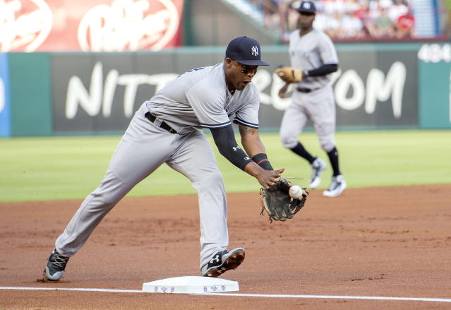 New York Yankees third baseman Miguel Andujar fields an infield hit by Texas Rangers' Isiah Kiner-Falefa during the first inning of a baseball game Tuesday, May 22, 2018, in Arlington, Texas. (AP Photo/Jeffrey McWhorter)