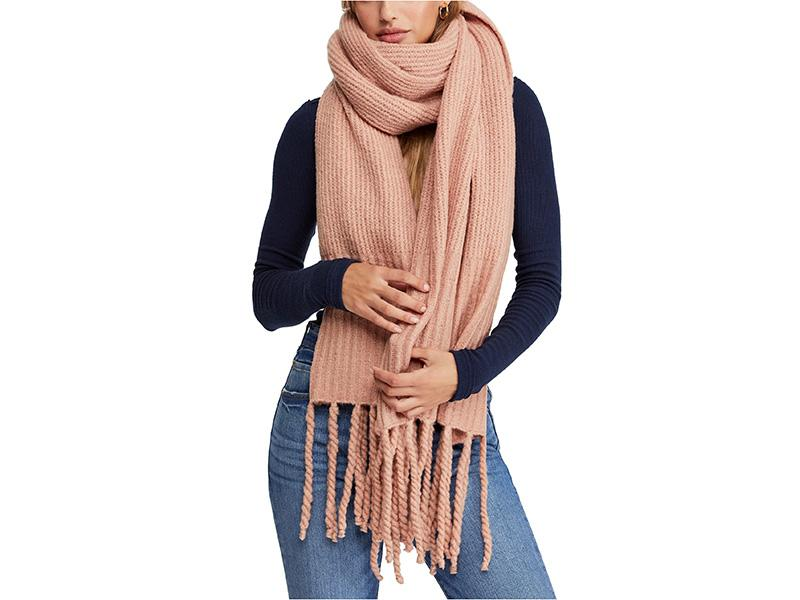 """""""Maximalism continues to be an important theme for accessories,"""" says Davignon who notes that a voluminous scarf adds extra warmth and comfort. """"A basic knit scarf becomes new in a chunky multi-knit fabrication with long fringe tassels as an added bonus."""" (Photo: Nordstrom) <a href=""""https://fave.co/2OmtyqR"""" rel=""""nofollow noopener"""" target=""""_blank"""" data-ylk=""""slk:SHOP IT:"""" class=""""link rapid-noclick-resp""""><strong>SHOP IT: </strong></a><strong>Free People Jaden Rib Knit Blanket Scarf, $48, </strong><a href=""""https://fave.co/2OmtyqR"""" rel=""""nofollow noopener"""" target=""""_blank"""" data-ylk=""""slk:nordstrom.com"""" class=""""link rapid-noclick-resp""""><strong>nordstrom.com</strong></a>"""