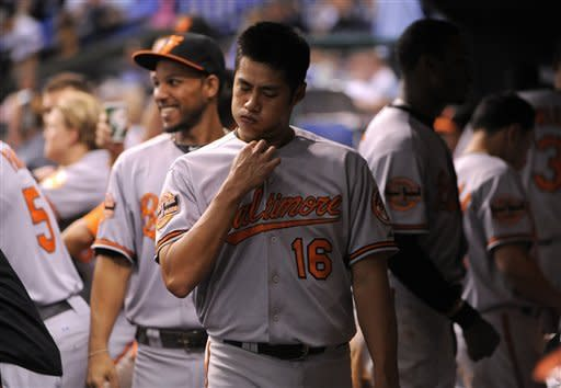 Baltimore Orioles starting pitcher Wei-Yin Chen (16), of Taiwan, comes into the dugout following the fourth inning of a baseball game against the Tampa Bay Rays, Saturday, Aug. 4, 2012, in St. Petersburg, Fla. (AP Photo/Brian Blanco)