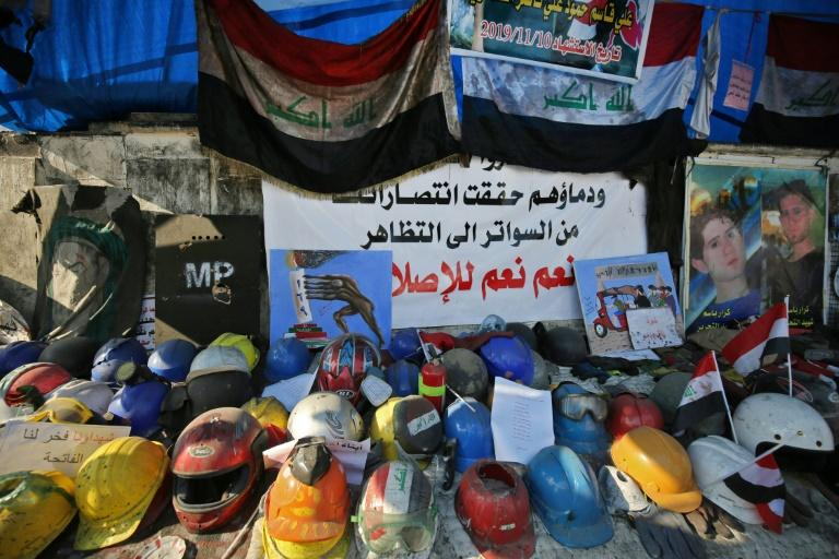 A shrine to honour the demonstrators who were killed during protests, made of their helmets and portraits, at Tahrir square in central Baghdad (AFP Photo/AHMAD AL-RUBAYE)
