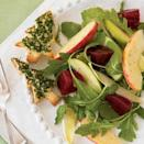 """<p>Fresh and full of crunch, this salad tosses baby arugula and Belgian endive together with red beets and Royal Gala and Granny Smith apples in a syrup-tinged olive oil–and-vinegar dressing.</p><p><strong><a href=""""https://www.countryliving.com/food-drinks/recipes/a30957/beet-apple-salad-maple-dressing-121276/"""" rel=""""nofollow noopener"""" target=""""_blank"""" data-ylk=""""slk:Get the recipe"""" class=""""link rapid-noclick-resp"""">Get the recipe</a>.</strong> </p>"""