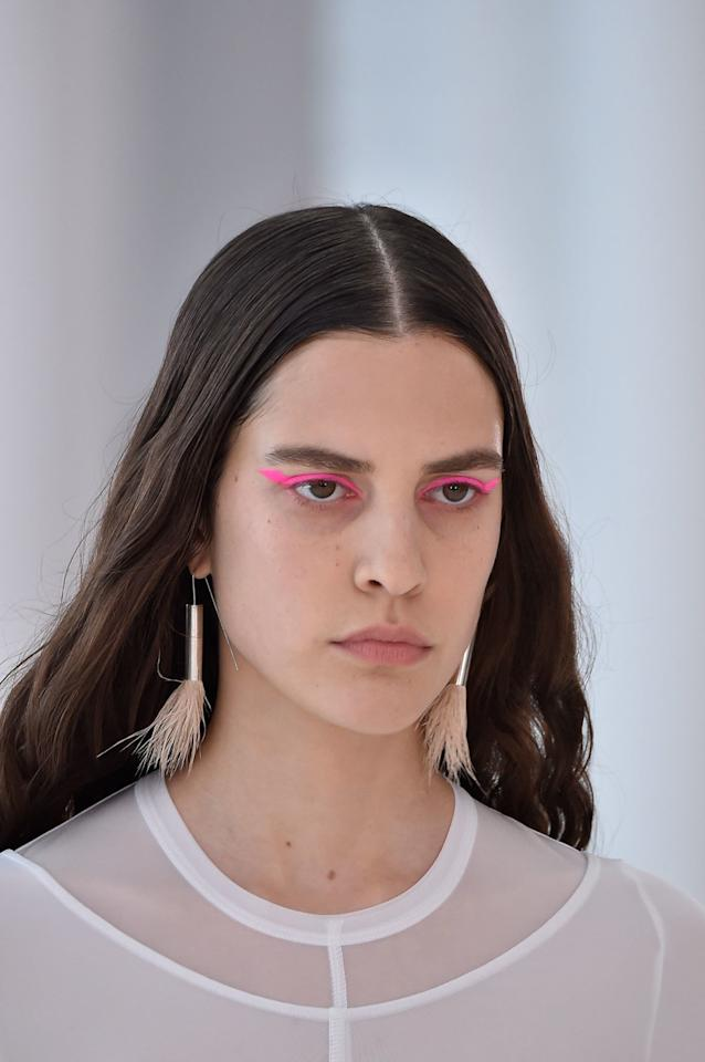 <p><strong>THE LOOK: </strong>Think pink. Models sported sharp, hot-pink cat eyes with little else on the face. Hair also seemed effortless, styled in what looks like air-dried waves with extra smoothing product to weigh down the roots. </p>