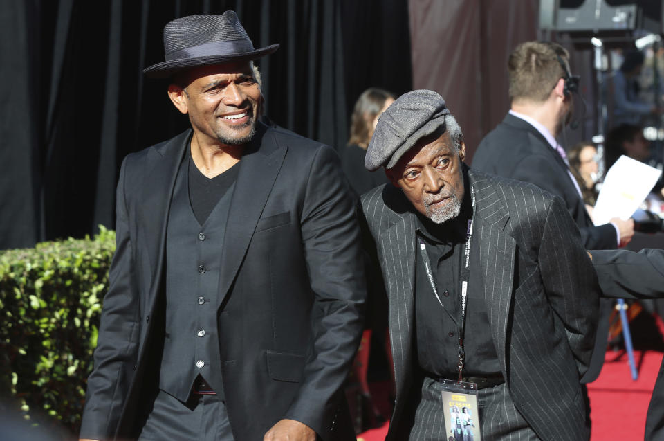 """FILE - Mario Van Peebles, from left and Melvin Van Peebles arrive at the screening of """"The Producers"""" at the 2018 TCM Classic Film Festival Opening Night at the TCL Chinese Theatre on Thursday, April 26, 2018, in Los Angeles. Melvin Van Peebles, a Broadway playwright, musician and movie director whose work ushered in the """"blaxploitation"""" films of the 1970s, has died at age 89. His family said in a statement that Van Peebles died Tuesday night, Sept. 21, 2021, at his home. (Photo by Willy Sanjuan/Invision/AP, File)"""