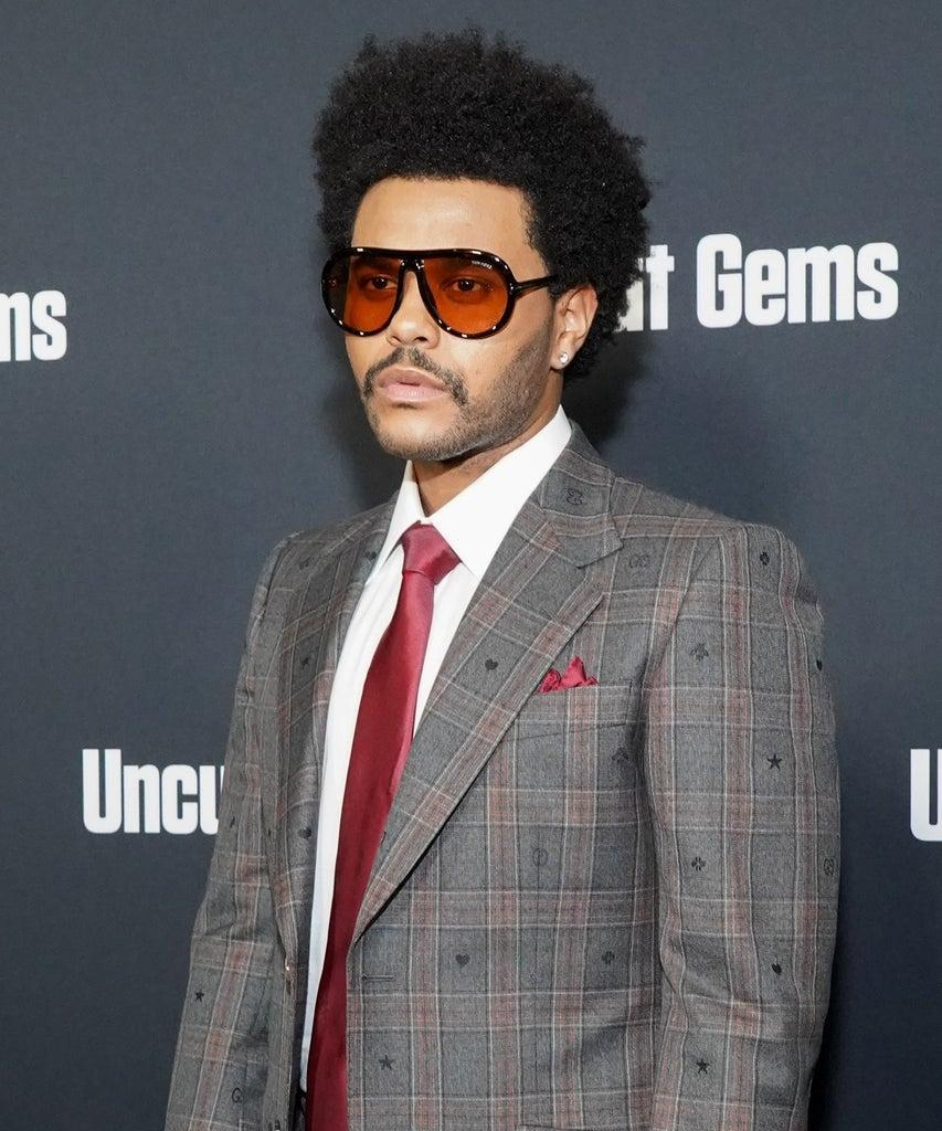 """HOLLYWOOD, CALIFORNIA – DECEMBER 11: The Weeknd attends the premiere of A24's """"Uncut Gems"""" at The Dome at Arclight Hollywood on December 11, 2019 in Hollywood, California. (Photo by Rachel Luna/WireImage)"""