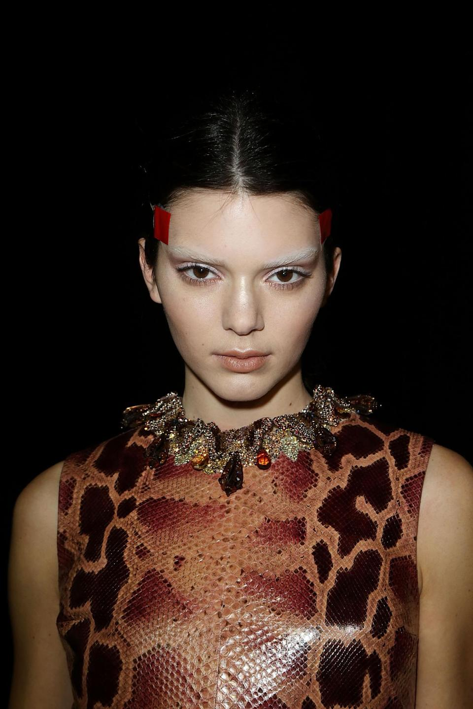 <p>At the Givenchy Fall 2014 show in Paris, Jenner debuted temporarily-bleached eyebrows with her nude makeup. <i>(Photo: Getty Images)</i></p>