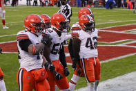 Cleveland Browns safety Karl Joseph (42) celebrates with teammates after intercepting a pass during the second half of an NFL divisional round football game against the Kansas City Chiefs, Sunday, Jan. 17, 2021, in Kansas City. (AP Photo/Charlie Riedel)