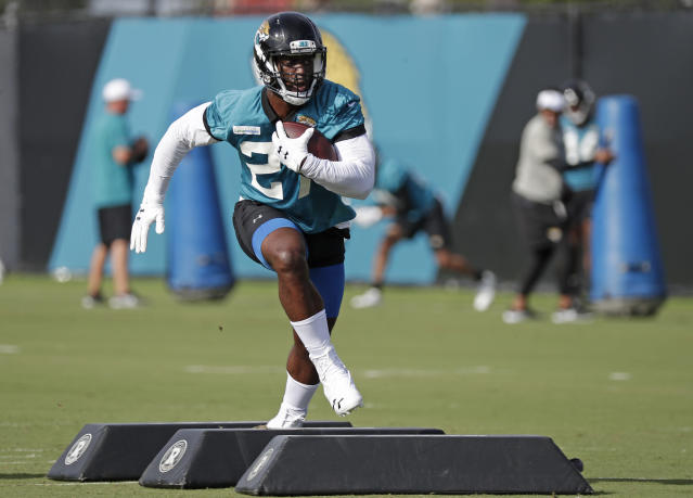Jacksonville Jaguars running back Leonard Fournette runs through a drill during an NFL football practice at the teams training facility, Friday, July 26, 2019, in Jacksonville, Fla. (AP Photo/John Raoux)