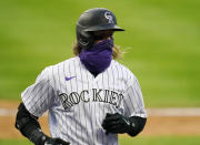 Colorado Rockies' Charlie Blackmon celebrates a run scored against the San Francisco Giants during the fourth inning of a baseball game, Tuesday, Aug. 4, 2020, in Denver. (AP Photo/Jack Dempsey)