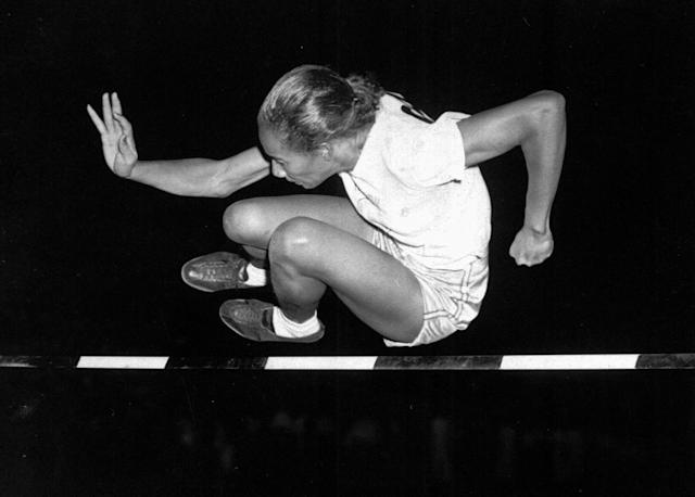 File-This July 8, 1948, file photo shows Alice Coachman of Albany, Ga., clearing the bar at five feet to win the running high jump in the Women's National Track Meet in Grand Rapids, Iowa. The first black woman to win an Olympic gold medal, Coachman Davis, died early Monday, July 14, 2014, in south Georgia. She was 90. (AP Photo, File)