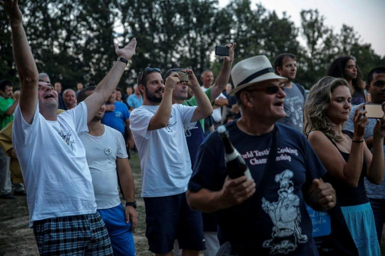 The crowd react at the announcement of the results of the 15th annual 'World Testicle Cooking Championship' in the village of Lipovica, Serbia on September 1, 2018