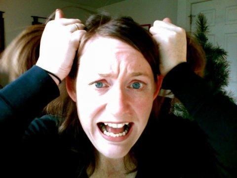 crazy girl face vexed angry fear afraid tearing hair out