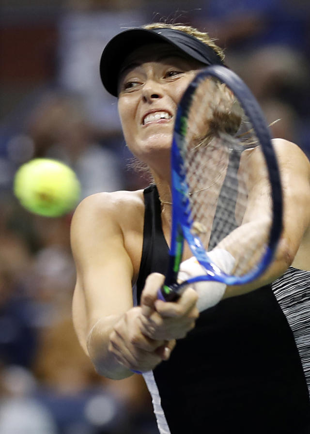 Maria Sharapova, of Russia, returns a shot to Jelena Ostapenko, of Latvia, during the third round of the U.S. Open tennis tournament, Saturday, Sept. 1, 2018, in New York. (AP Photo/Adam Hunger)