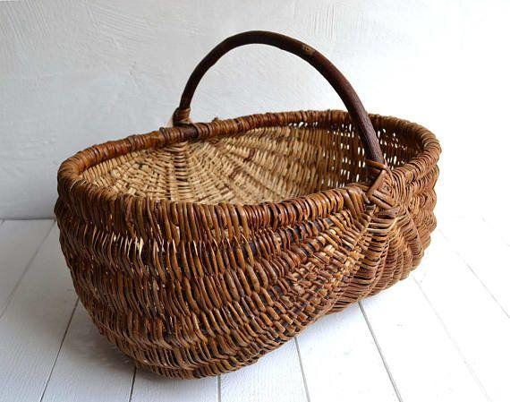 """Use this basket to store crafts, throw blankets or magazines beside your favorite armchair. <a href=""""https://www.etsy.com/listing/545258667/large-vintage-french-rustic-wicker"""" target=""""_blank"""">Shop it here</a>."""