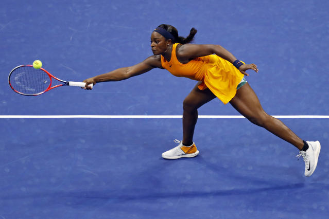 Sloane Stephens, of the United States, reaches for a shot from Elise Mertens, of Belgium, during the fourth round of the U.S. Open tennis tournament Sunday, Sept. 2, 2018, in New York. (AP Photo/Adam Hunger)