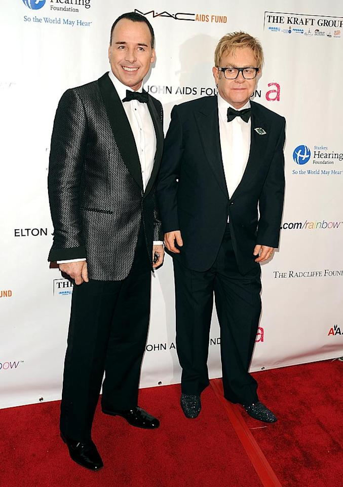 "Elton John proved he was still standin' by attending with longtime partner David Furnish. The Grammy-winning singer was recently hospitalized due to the flu and an E. coli infection. Andrew H. Walker/<a href=""http://www.wireimage.com"" target=""new"">WireImage.com</a> - November 16, 2009"