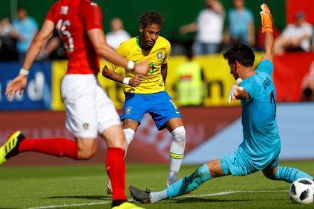 Soccer Football - International Friendly - Austria vs Brazil - Ernst-Happel-Stadion, Vienna, Austria - June 10, 2018 Brazil's Neymar scores their second goal REUTERS/Leonhard Foeger