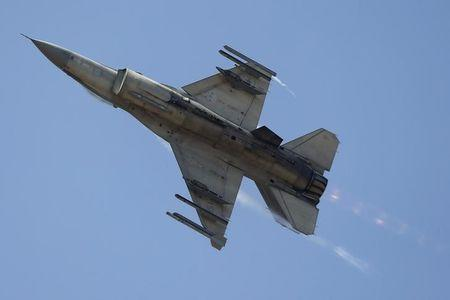 A F-16 jet fighter flies during the International Air and Space Fair (FIDAE) at the international airport of Santiago