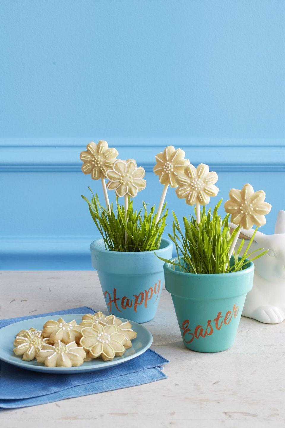 """<p>These adorable daisy cookies are easy to make and fun to decorate, and no matter how you choose to display them, they'll be sure to brighten up your dessert table at your next Easter gathering. </p><p><strong><em><a href=""""https://www.womansday.com/food-recipes/food-drinks/recipes/a58136/spritz-daisy-cookies-recipe/"""" rel=""""nofollow noopener"""" target=""""_blank"""" data-ylk=""""slk:Get the Spritz Daisy Cookies recipe."""" class=""""link rapid-noclick-resp"""">Get the Spritz Daisy Cookies recipe. </a></em></strong></p>"""